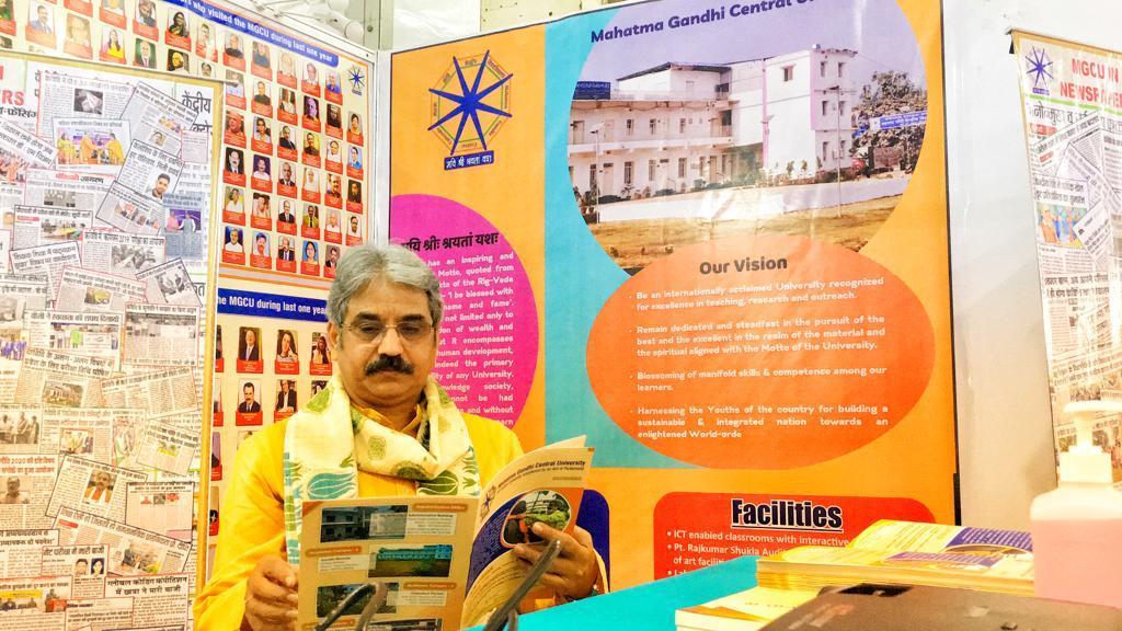 Sarthak EduVision Bhopal: Mahatma Gandhi Central University Vice Chancellor Prof Sanjeev Sharma reading university booklet